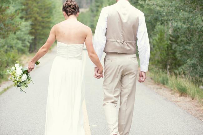 colorado bride and groom hold hands