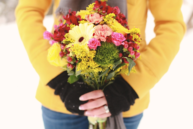Colorado bride in a bright yellow pea coat holding a colorful bouquet