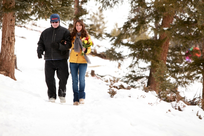 Dad walks Colorado bride down a snowy path