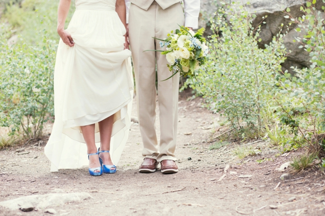blue wedding shoes and green and white bouquet