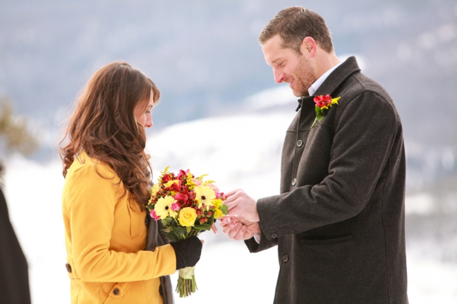 Colorado groom places ring on brides finger