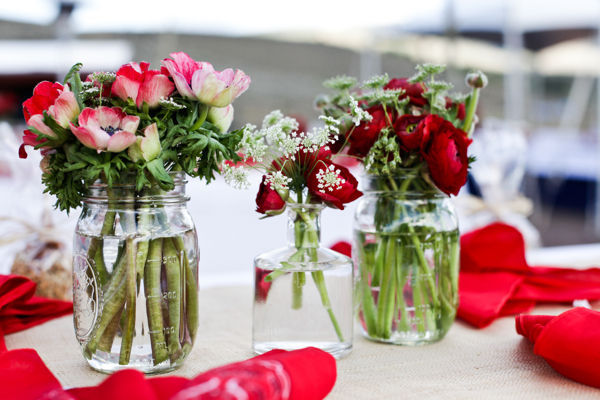 red flowers in rustic mason jars