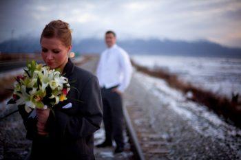 alaska bride and groom on railroad tracks
