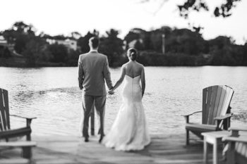 knoxville bride and groom holding hands at a lake