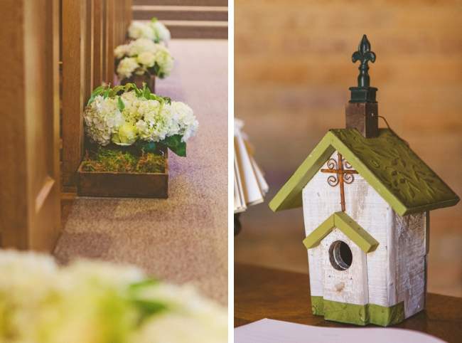 church birdhouse and boxed flowers