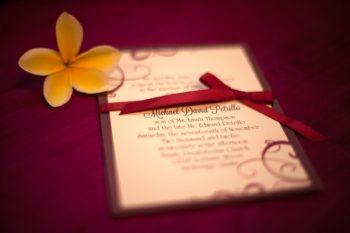 maroon and swirls wedding invitation