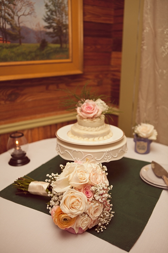 Small wedding cake and rose bouquet