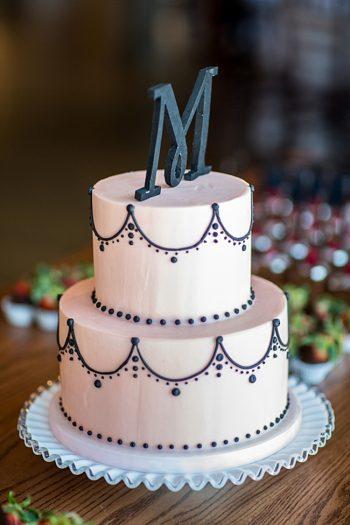 blush pink wedding cake with black monogram