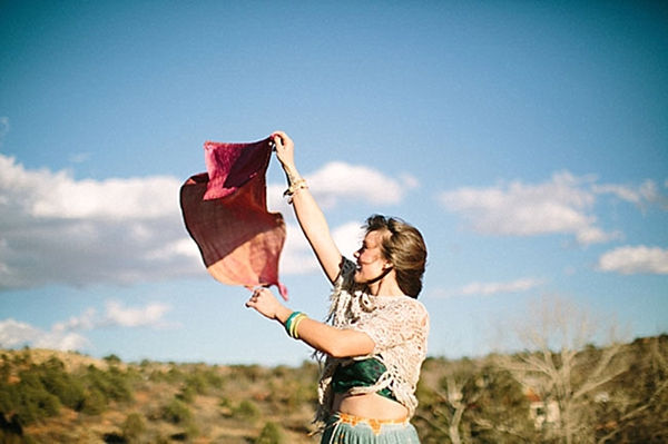 woman waves ribbon in the wind