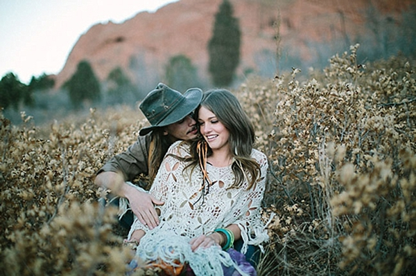 engaged colorado couple in a field