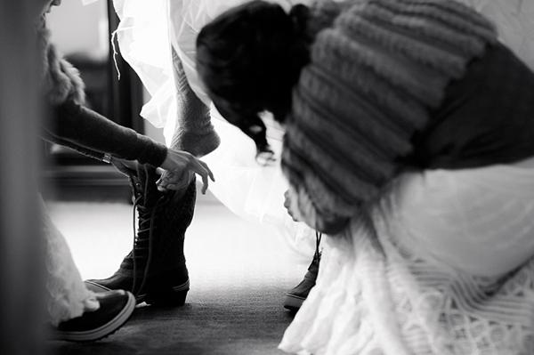 bride putting on her wedding sorrels getting ready via Gavin Farrington Photography