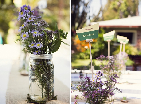 wildflowers in mason jars and forest service sign table numbers