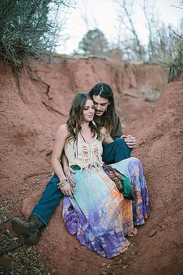 engaged colorado couple in front of red dirt