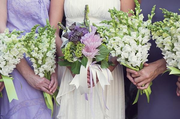purple bridesmaids dresses and bouquet