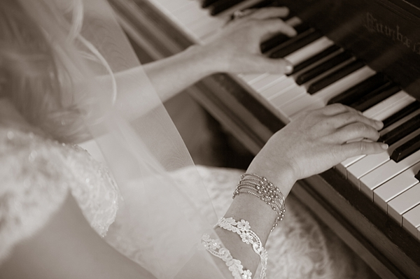 bride plays a vintage chuch piano