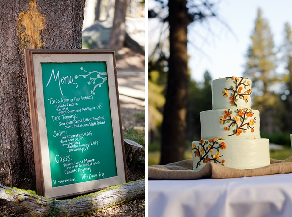 chalkboard menu and rustic wedding cake with orange and yellow fondant leaves