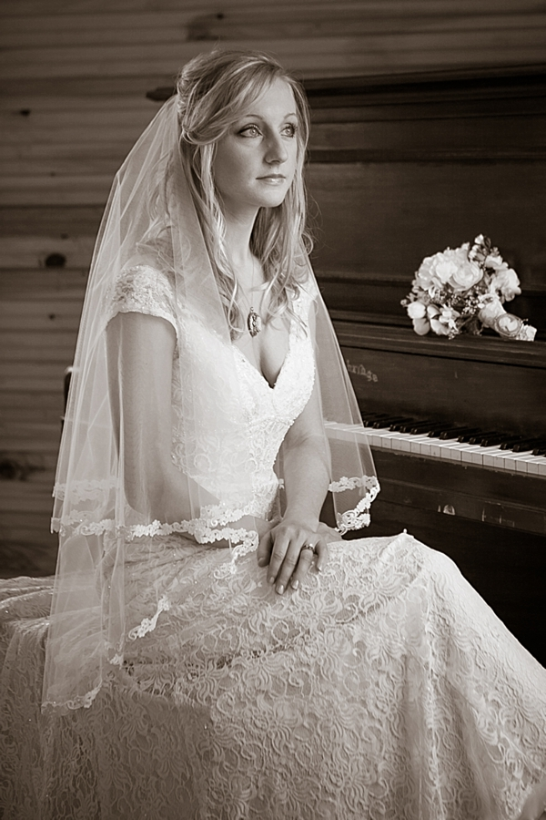 bride sits at a vintage chuch piano