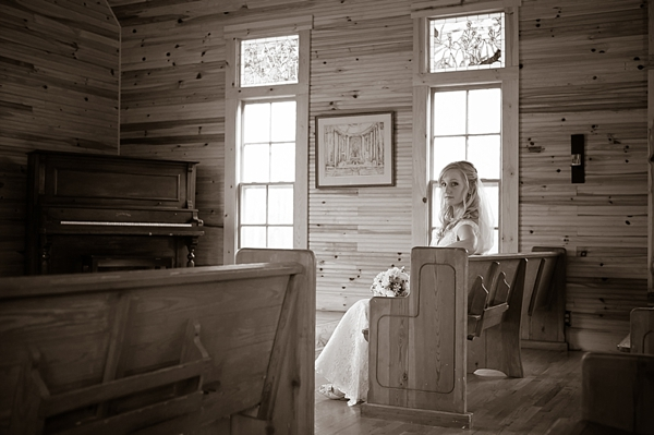 Bride in front pew of old church