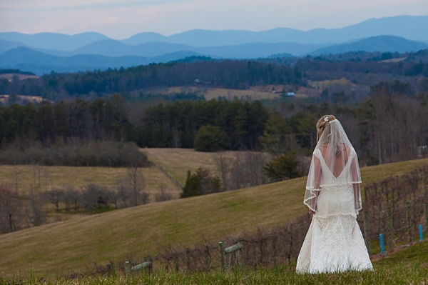 Bride on hilltop with smoky mountains in the distance