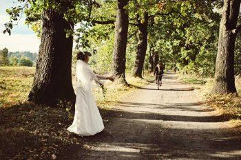 biking groom and hitchhiking bride