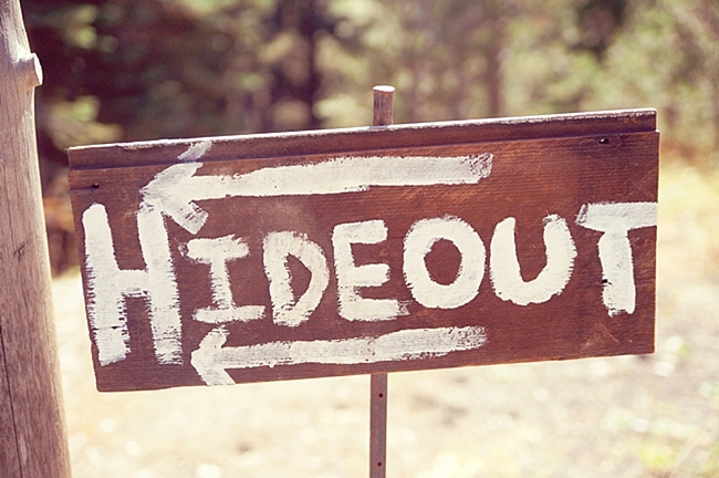 wooden hide out sign