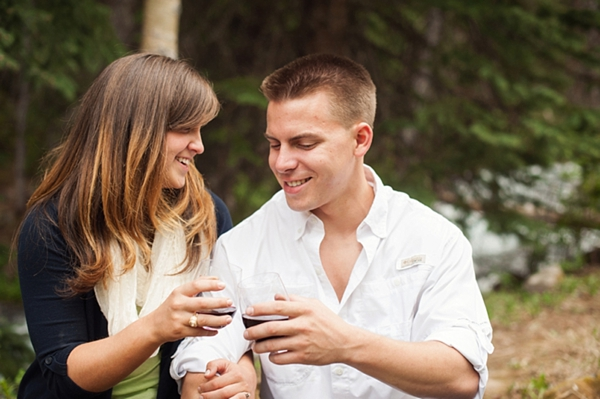 aspen engagement couple drinking wine
