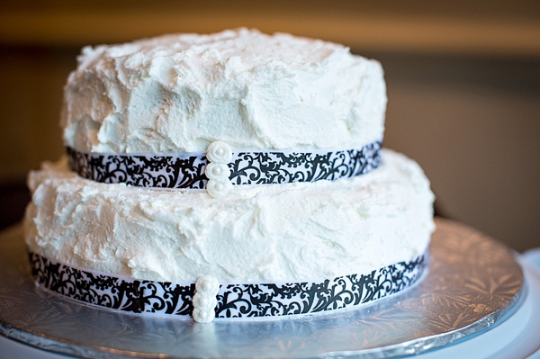 wedding cake with damask ribbon