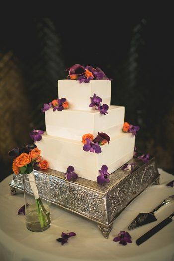 Wedding cake with orange and purple flowers