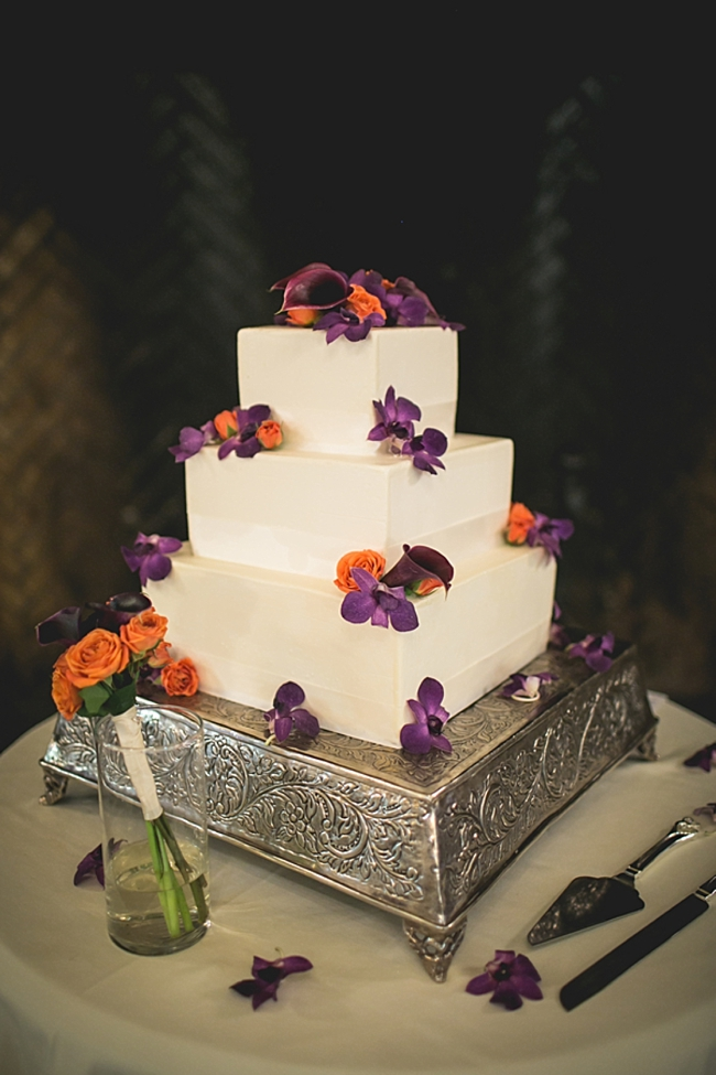 Wedding cake with orange and purple flowers
