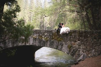 Bride and groom on Ahwanee bridge