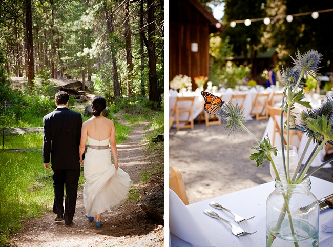 Butterfly lands on wildflower centerpiece and bride and groom stroll through the woods