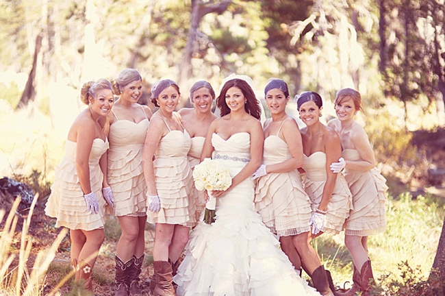 Bride with bridesmaids wearing cream and beige dresses