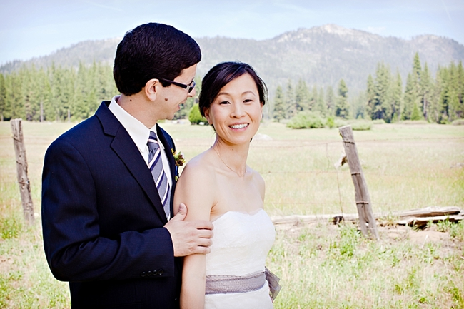 Yosemite bride and groom in a meadow with mountains in the background