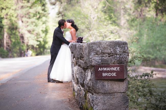 Bride and Groom on Ahwanee bridge in Yosemite