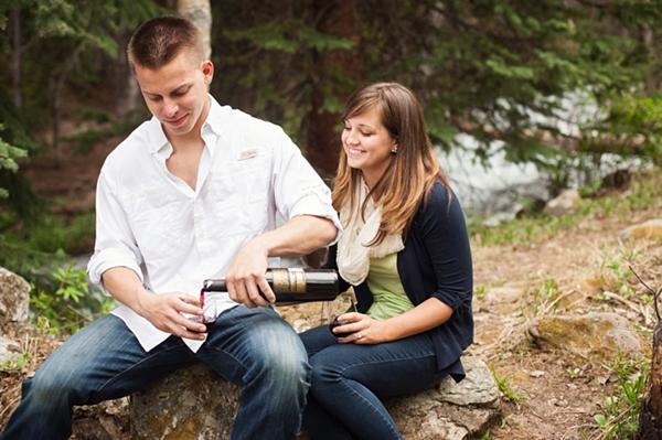 aspen engagement man pouring wine