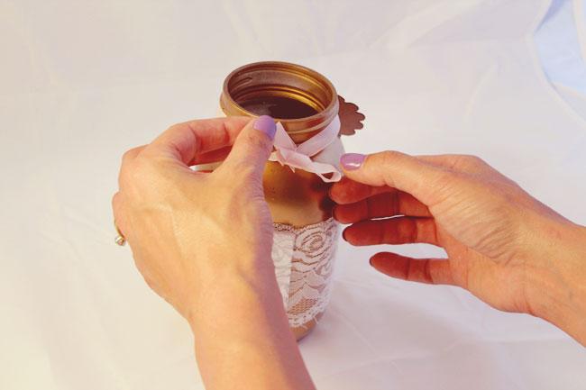tie tag ribbon around gold painted mason jar