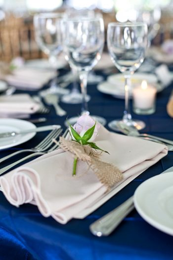 burlap wrapped napkin on a navy tablecloth | New Hampshire Mountain Wedding