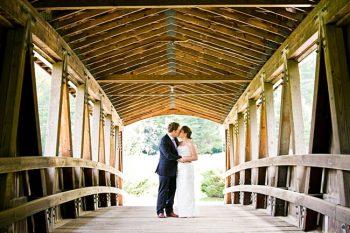 Couple under covered bridger   New Hampshire Mountain Wedding