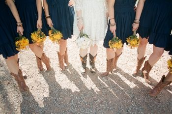 navy bridesmaid dresses with yellow bouquets by Gaby J Photography