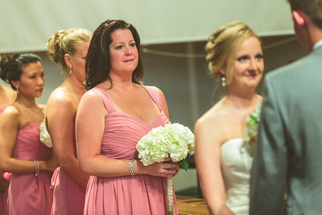 bridesmaids in pink at a church ceremony