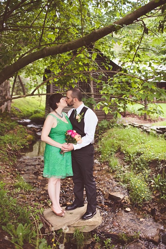valle crucis elopement couple kiss near stream