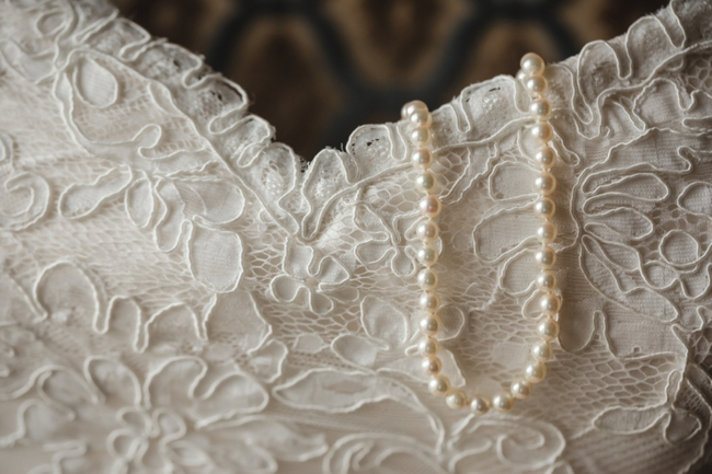 Lace wedding gown and pearls