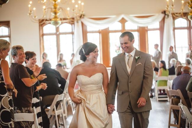bride and grrom walk back down the aisle