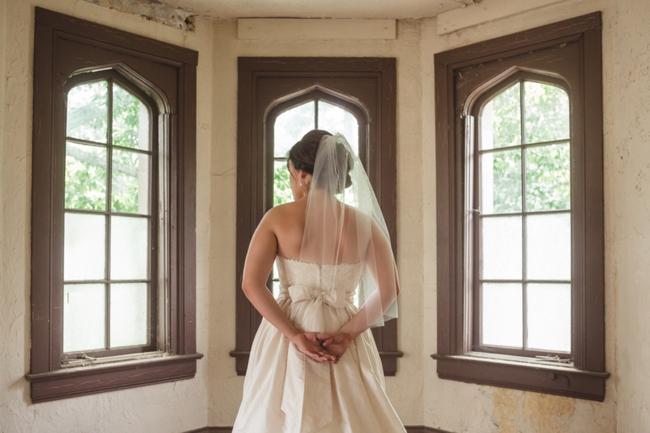 Bride in an old manson bay window