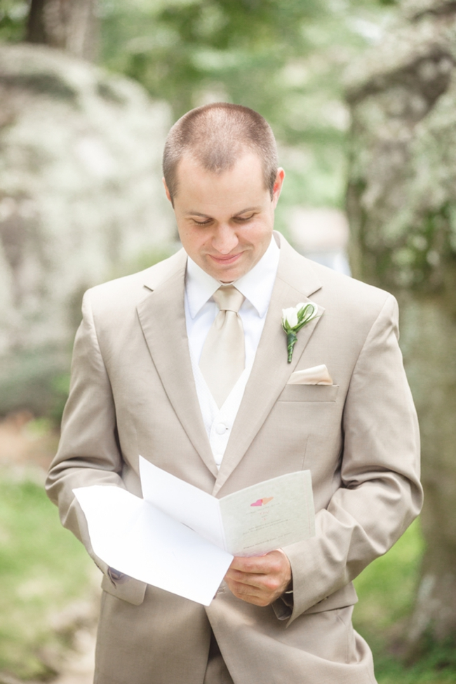 groom reading a wedding day letter