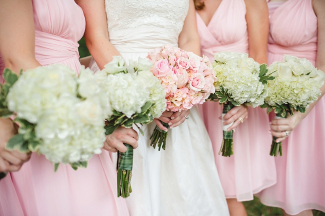 pink bridesmaids dresses with white hydrangea bouquets