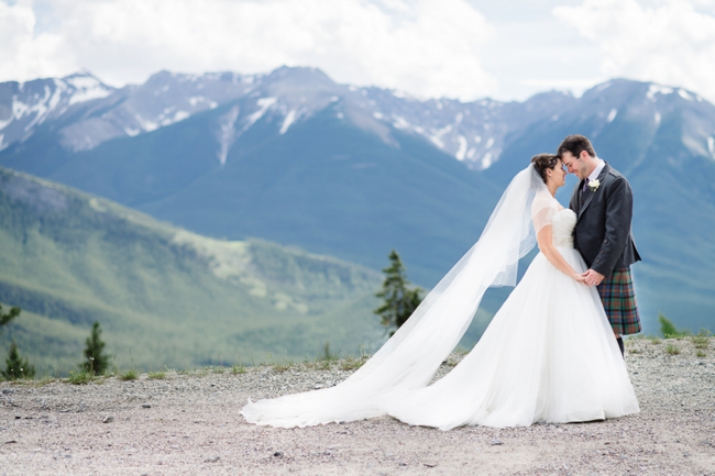 bride and groom and mountain backdrop