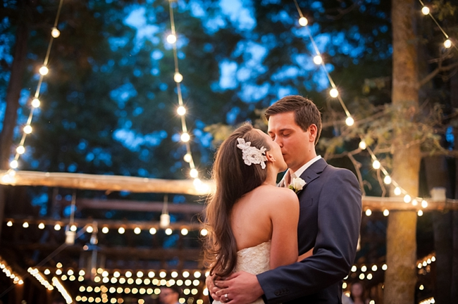 15-bride-and-groom-kiss-under-Italian-lights-True-Bliss-Photography