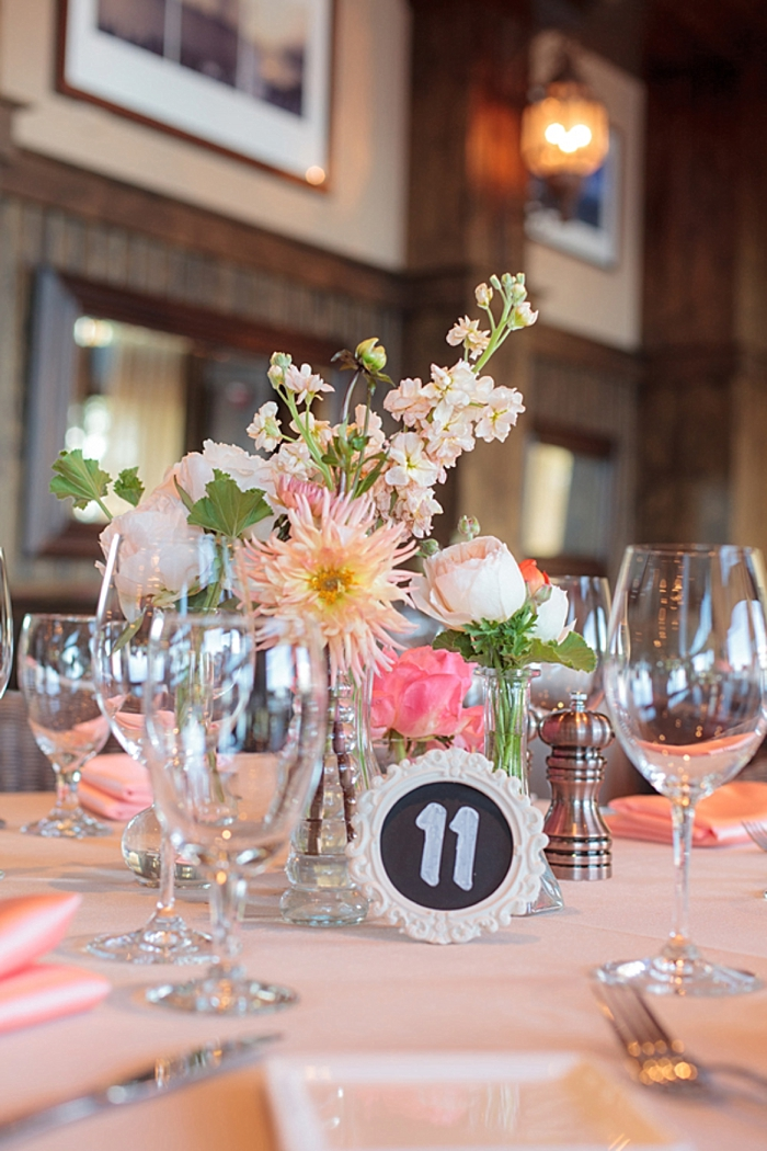 pink and peach center piece with chalkboard table number https://mountainsidebride.com