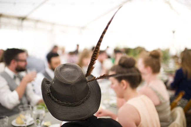 feather hat | casual winter park wedding